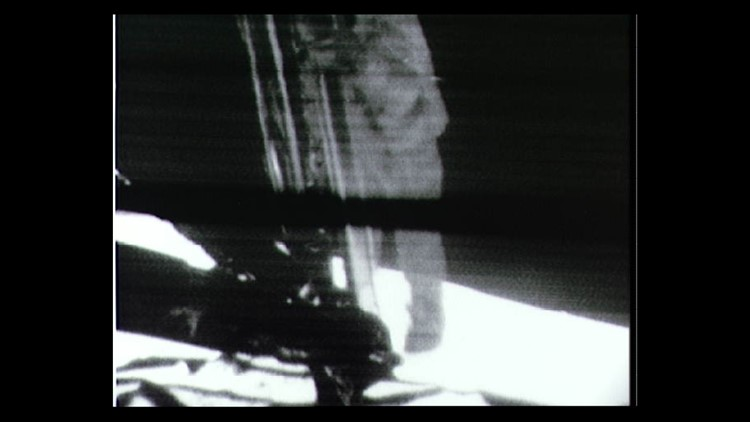 Astronaut Neil Armstrong makes his way down the LEM ladder on July 20, 1969.