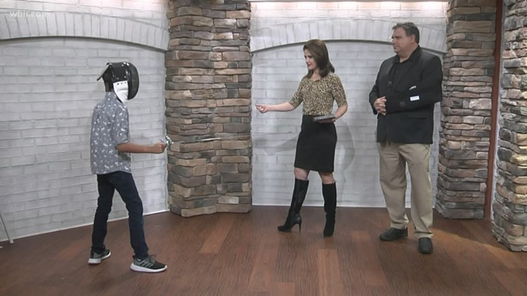 En garde: Tristan shows Beth & Russell some fencing moves