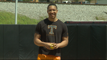 Tennessee's Grant Williams throws out the first pitch for Lady Vols