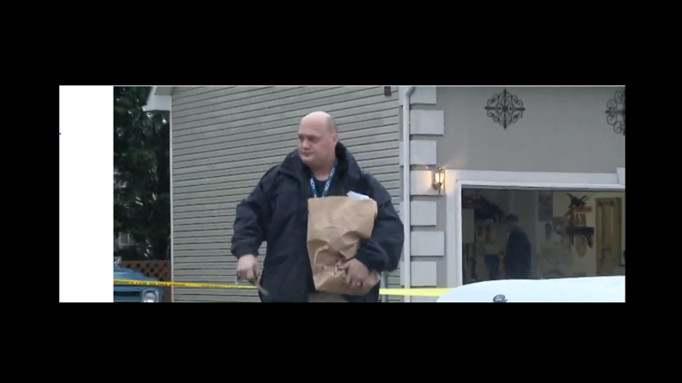 Authorities remove evidence from Guy home.