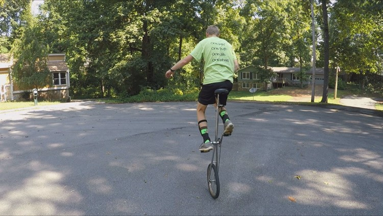 Carter Rivera demonstrates how to ride a tall unicycle