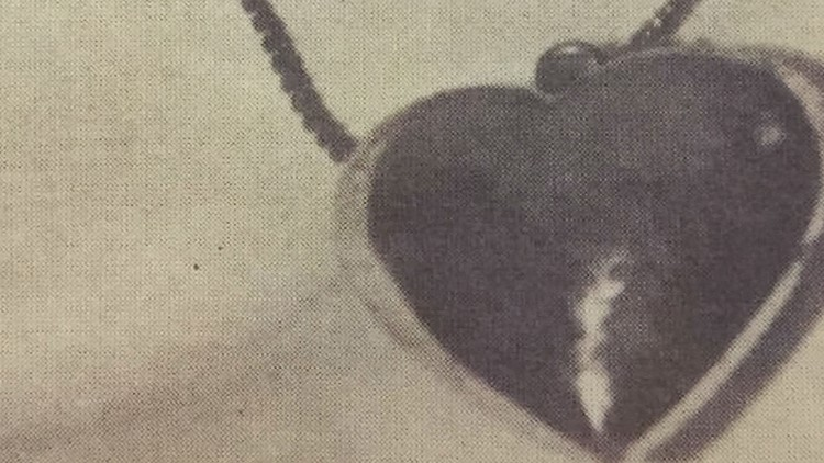 A close-up of the heart pendant the woman was wearing when she was found.