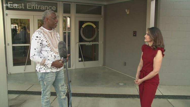 Pastor Daryl Arnold speaks with WBIR anchor Beth Haynes following Austin-East shooting