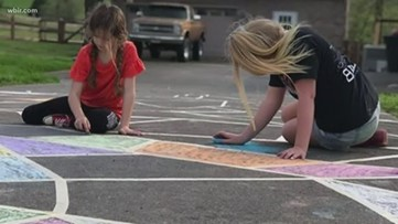Chalk art brings messages of hope, positivity