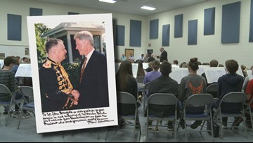 Former director of 'The President's Own' Marine Band directs local high school band