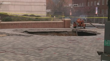 Massive hole caused by water main break