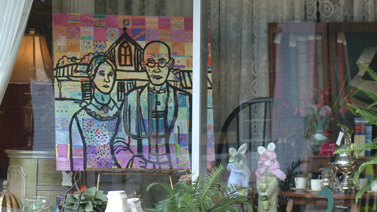 Student artwork displayed along street during event to support art education