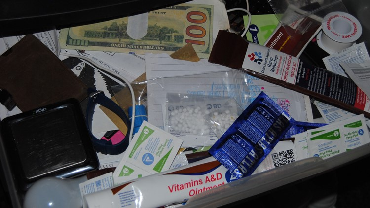 Sheriff: Cocke County raid reveals man hiding behind trap door, drugs, cash, scales and ammo