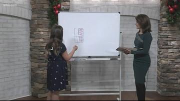 Junior Anchor Adah Swanger demonstrates equivalent fractions
