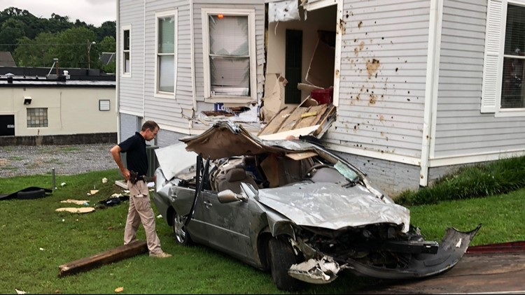 Knoxville Police said a jogger reported she found a crashed car between buildings. When officers got there, they found the driver still trapped inside.