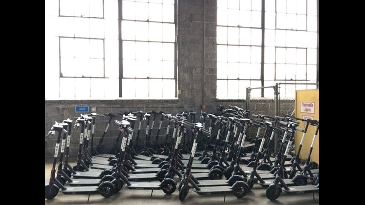 Scooters locked up this summer in Nashville.