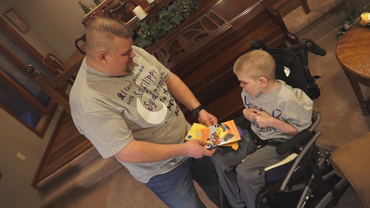Chester Hembree shows Lucas a birthday card sent from a family in Texas