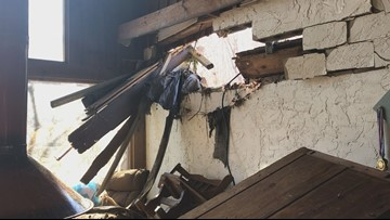 Roane County home in ruins after heavy rain forces pond water into their home