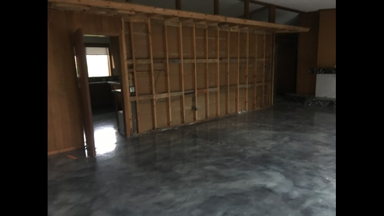 Stripped down living room of former Busch home