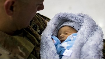 Fort Campbell soldier returns home, meets newborn son for first time in time for Thanksgiving