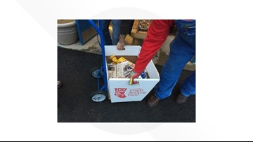 Volunteers prepare Empty Stocking Fund donation baskets