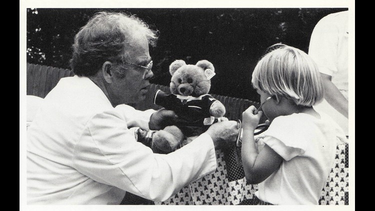 Dr. Hyram Kitchen examines a child's teddy bear at UTCVM open house. Courtesy UTCVM