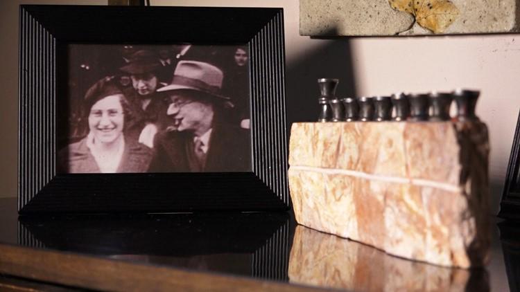 Photo of Sonja DuBois biological parents beside a Jewish menorah