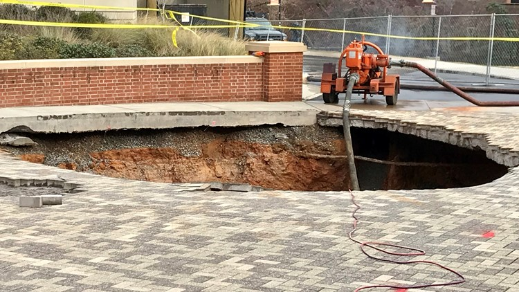 Water main break on UT campus opens hole on the Hill