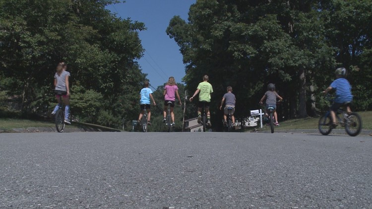 One-wheel wonders on the road on their unicycles