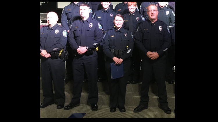 Lt. Travis Brasfield of KPD shown on right at a 2015 promotion event.