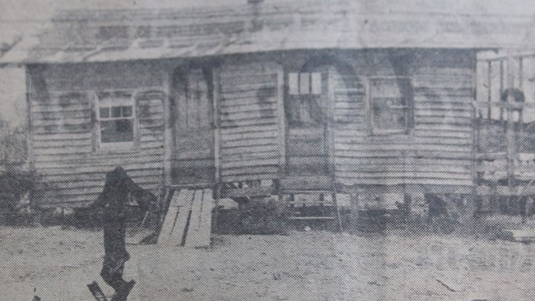 The Lutz home, with an arrow pointing to the window through which the shot was fired.