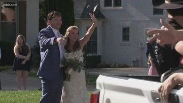 Couple invites friends to drive-by wedding reception