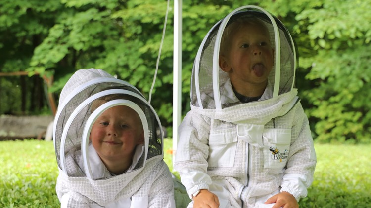 Hand and Gus Bergin are mini-beekeepers
