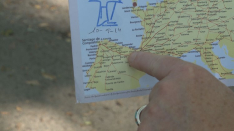Leslie King points to the Camino de Santiago route on her map