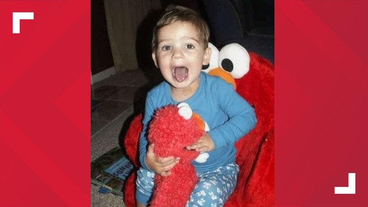 """Tucker and his """"Melmo"""" sitting in his Elmo chair"""