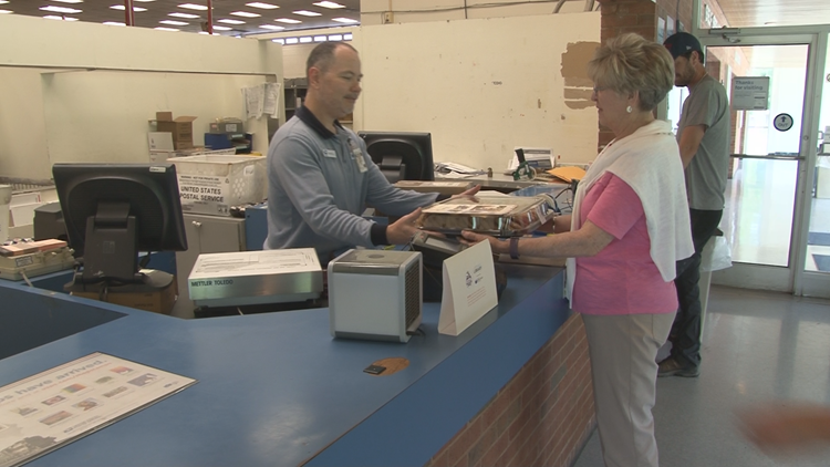 Imagination Library delivers cookies and thank you cards to postal workers.