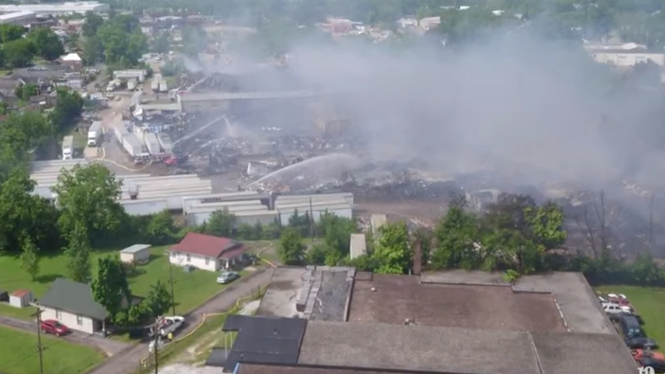 The sprawling fire prompted neighborhood evacuations.