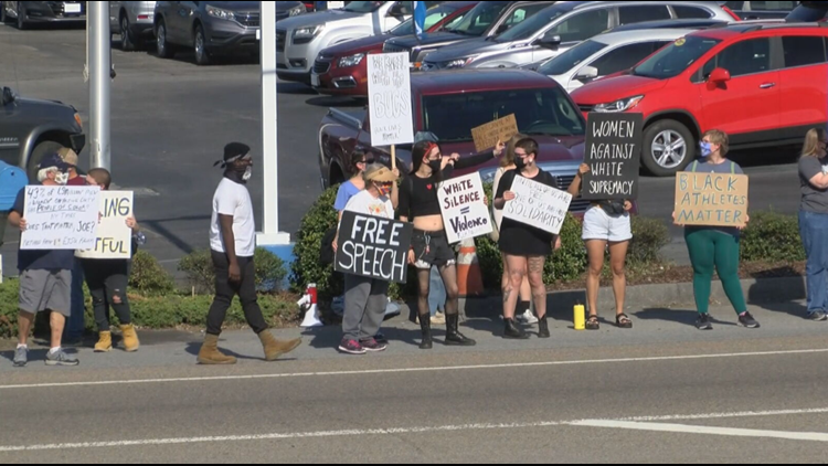 Protesters rally outside Johnson City Honda in support of former ETSU head basketball coach