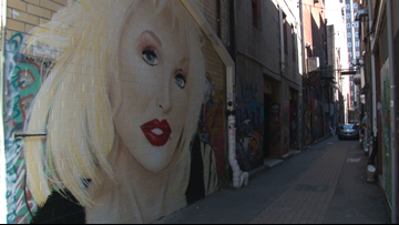 Downtown Dolly! Strong Alley mural brings Dolly Parton's likeness to Market Square area