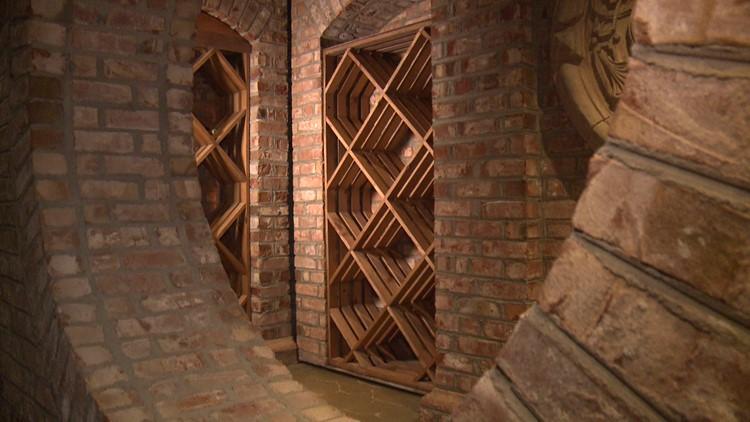 The wall of the wine cellar at Villa Collina is also hidden mechanical door.