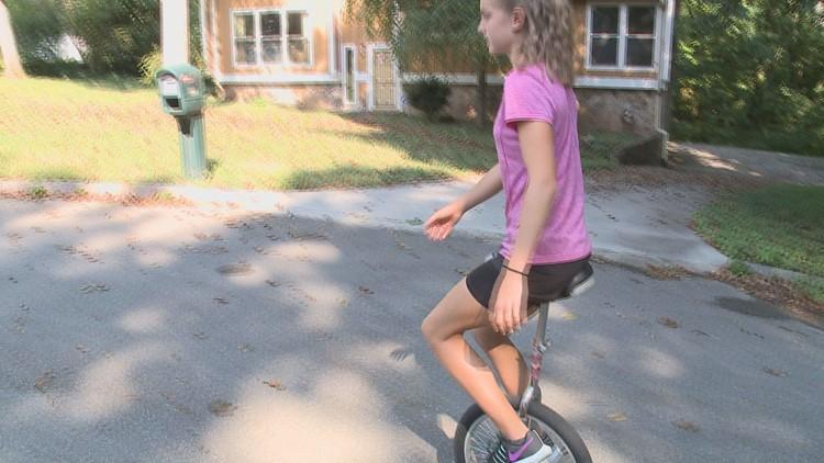 Savannah Rivera rides a unicycle