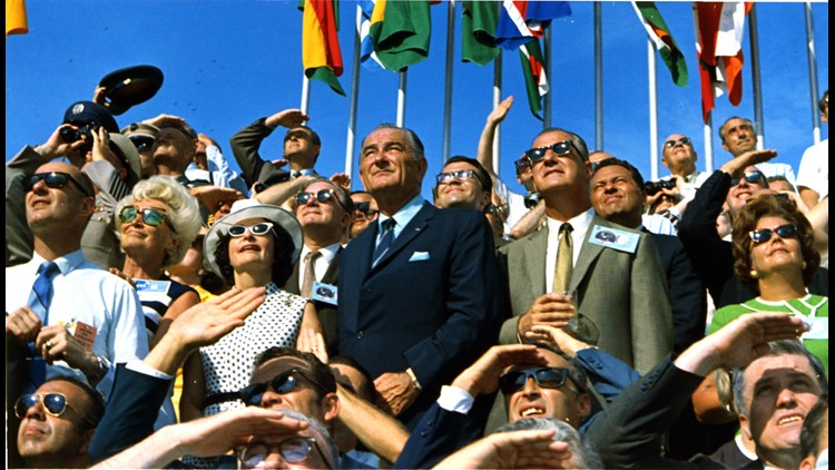 LBJ, Lady Bird Johnson and Spiro Agnew watch in the VIP section as Apollo 11 takes off.
