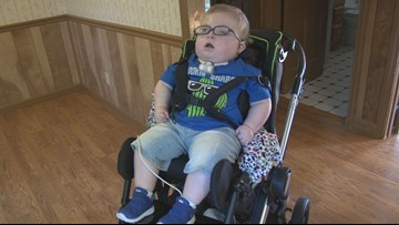 Donations help family of boy with special needs buy their first home