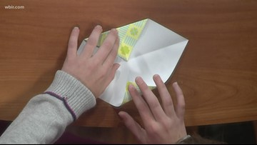 Jr. Anchor teaches Russell and Beth origami