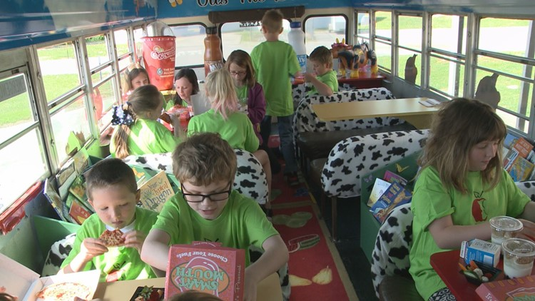 Gus the Bus in Morgan County features tables and benches and sky painting on the roof