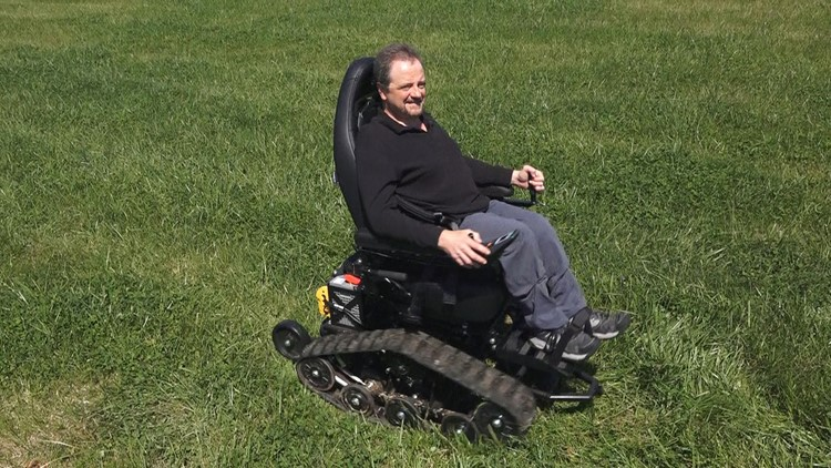 Greg Tipton demonstrates the zero turn radius on his all-terrain chair.