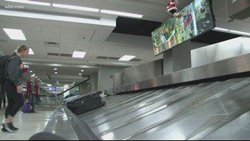 Passengers fly through busy holiday travel