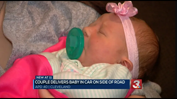 'SHE'S COMING OUT': Cleveland couple delivers baby in car on the side of the road