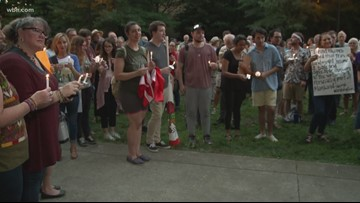Dozens gather at Krutch Park to protest migrant camp conditions