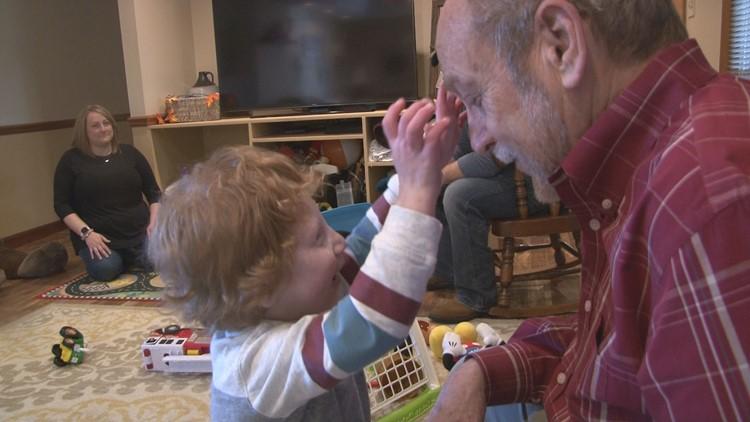 Jaxson Cope plays peek-a-book with his grandfather Michael Julian
