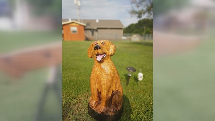 Jeff Banning carved this dog from a log