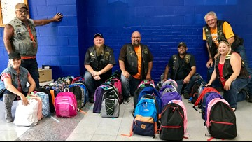 Pay It Forward: Vendetta's Motorcycle Club donates backpacks to Claxton Elementary School