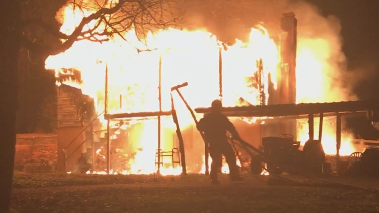Burning home of Leroy Hallcox roane county man rescued by woman with hammer