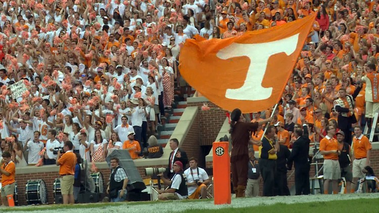 "UT fans sing ""Rocky Top"" after a touchdown in Neyland Stadium."