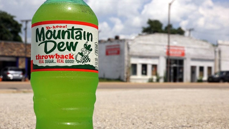 Mountain Dew throwback bottle in front of the original Hartman Beverage Company building on Magnolia Ave.
